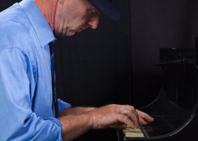 John Finbury of Green Flash Music on Piano Photo